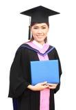 Beautiful graduation girl holding her diploma. Happy beautiful graduation girl holding her diploma Royalty Free Stock Photography