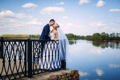 Happy and beautiful groom and bride tender kiss at spring outdoo Stock Photos