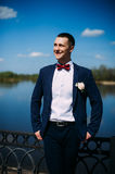 Happy and beautiful groom at spring outdoors at the beach of the Royalty Free Stock Photography