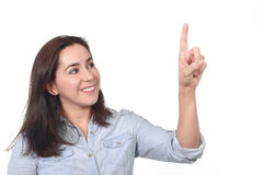 Happy beautiful Hispanic woman pointing with finger on blank copy space smiling confident isolated Stock Photography
