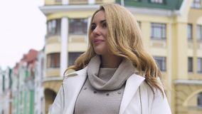 Happy beautiful lady in fashionable residential area looking at house, customer. Stock footage stock footage