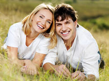 Happy beautiful laughing couple on nature royalty free stock photo