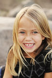 Happy Beautiful Little Girl. A pretty blonde girl smiles at the camera royalty free stock image