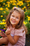 Happy beautiful little girl with flowers. Stock Image