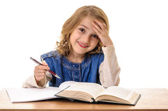 Happy beautiful little girl learning at school Stock Photos