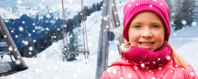 Happy beautiful little girl over winter background Royalty Free Stock Photography