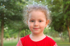 Happy beautiful little girl portrait outdoors Stock Photo