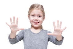Happy beautiful little girl showing her hands isolated Royalty Free Stock Image