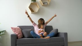 Happy beautiful loving family young mother and daughter laughing sitting on the couch, monkeying and fool around. Happy beautiful loving family young mother and stock footage