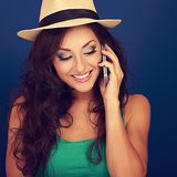Happy beautiful makeup woman talking on mobile phone in summer h Stock Photo