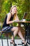 Happy beautiful mode in cafe with laptop Royalty Free Stock Image