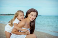 Happy beautiful mother and daughter enjoying beach time Stock Image