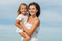 Happy beautiful mother and daughter enjoying beach time Royalty Free Stock Photography