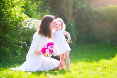 Happy beautiful mother and her daughter in garden Royalty Free Stock Images
