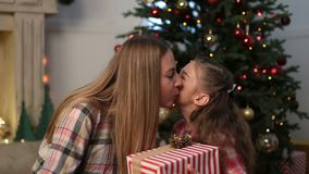 Lovely daughter giving Christmas present to mother stock video