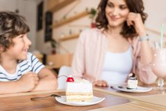 Happy beautiful mother and son. In cafe Royalty Free Stock Photography