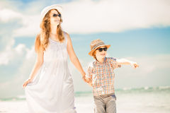 Happy beautiful mother and son enjoying beach time Royalty Free Stock Image