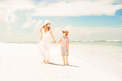 Happy beautiful mother and son enjoying beach time Royalty Free Stock Photos