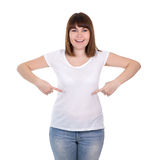 Happy beautiful plus size woman pointing on blank white t-shirt Royalty Free Stock Photography