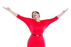 Happy beautiful plus size woman in red dress with hands up isola Royalty Free Stock Image