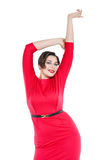 Happy beautiful plus size woman in red dress with hands up Royalty Free Stock Photo