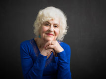 Happy and beautiful portrait of elderly woman Stock Images