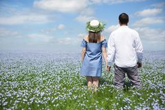 Happy beautiful pregnant couple in linen field Royalty Free Stock Image