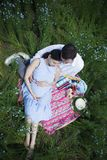 Happy beautiful pregnant couple in linen field Royalty Free Stock Photos