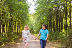 Happy beautiful pregnant woman and her husband outdoors Stock Image