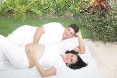 Happy beautiful pregnant woman with his husband outdoors Royalty Free Stock Image