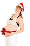 Happy beautiful pregnant woman in Santa hat Royalty Free Stock Image