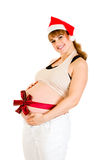 Happy beautiful pregnant woman in Santa hat Stock Photography