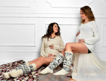 Happy beautiful pregnant women friends sitting talking and smili Royalty Free Stock Images