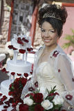 Happy Beautiful Quinceanera Holding Flowers Stock Photography