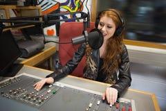 Happy beautiful radio host moderating Stock Photo