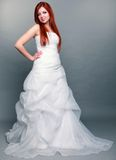 Happy beautiful red haired bride on gray background Royalty Free Stock Photography