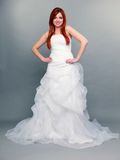 Happy beautiful red haired bride on gray background Stock Photo