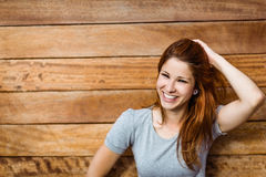 Happy beautiful redhead touching her hair Royalty Free Stock Photos