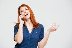 Happy beautiful redhead young woman talking on mobile phone Royalty Free Stock Photography