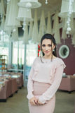 Happy beautiful restaurant administrator or manager. Restaurant is on background. Woman owner Stock Photos