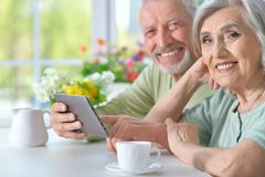 happy beautiful senior couple using tablet Stock Photography