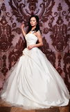 Beautiful bride in white wedding dress Stock Photos