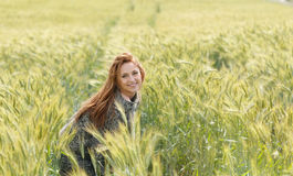 Happy beautiful smiling young woman in the autumn field Royalty Free Stock Photography