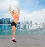 Happy beautiful sporty woman dancing Stock Image