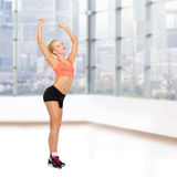 Happy beautiful sporty woman dancing Stock Images