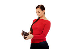 Happy beautiful student woman holding wallet Stock Photos