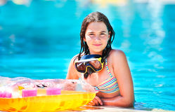 Happy beautiful teen girl smiling at the pool Royalty Free Stock Images