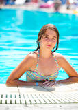 Happy beautiful teen girl smiling at the pool Stock Photo