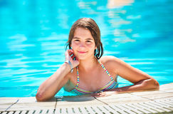 Happy beautiful teen girl smiling at the pool Stock Photos