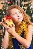 Happy beautiful teenager girl`s shaking their Christmas present stock photography
